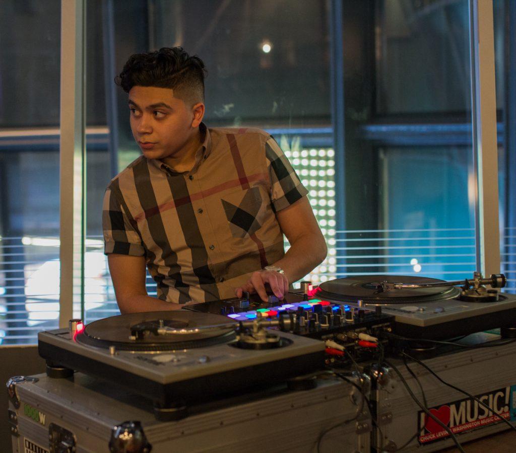 Fashion show DJ in plaid shirt
