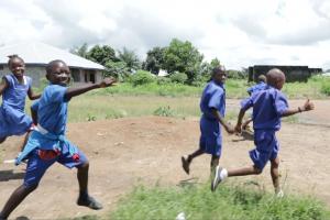Children in Burma IV district joyfully greeting the van of churchgoers
